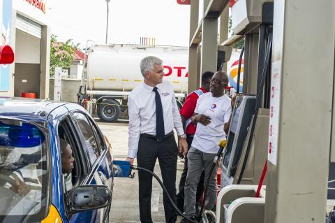 managing_director_of_total_ghana_eric_fanchini_despensing_fuel.jpg